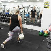 Single leg squats with kettlebells